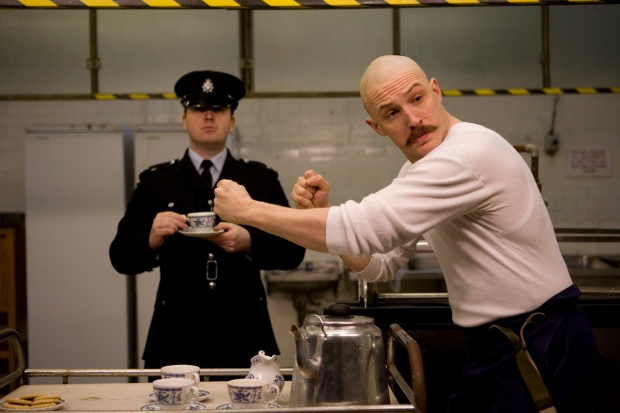 A ridiculously amusing scene, what with a mild mannered police officer getting tea from a madman